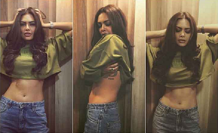 Hot pictures of actress Esha Gupta flaunting her tattoo 'Alis Volat Propriis'.